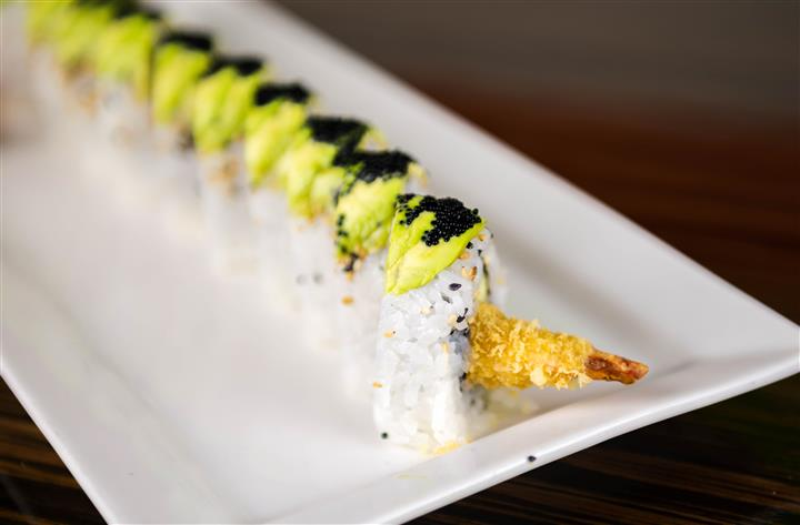 sushi on a plate with garnish