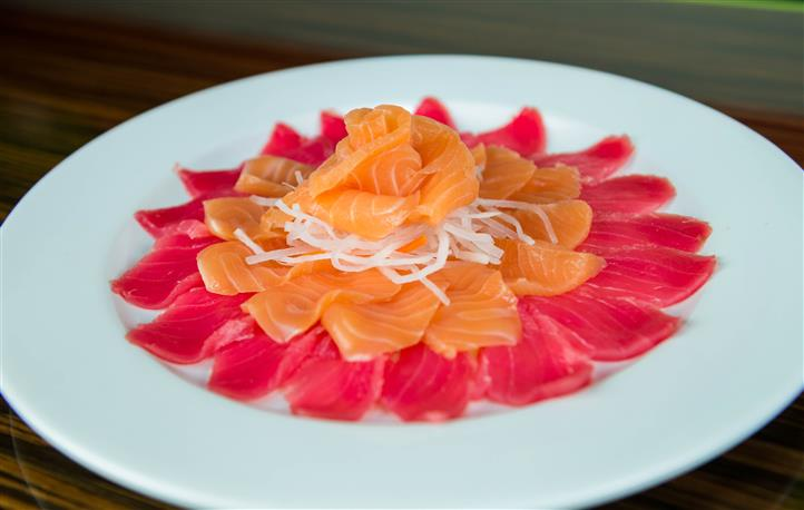 decoratively-spread sliced fish on a dish