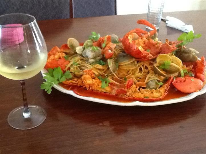 a large variety of shellfish served over linguine