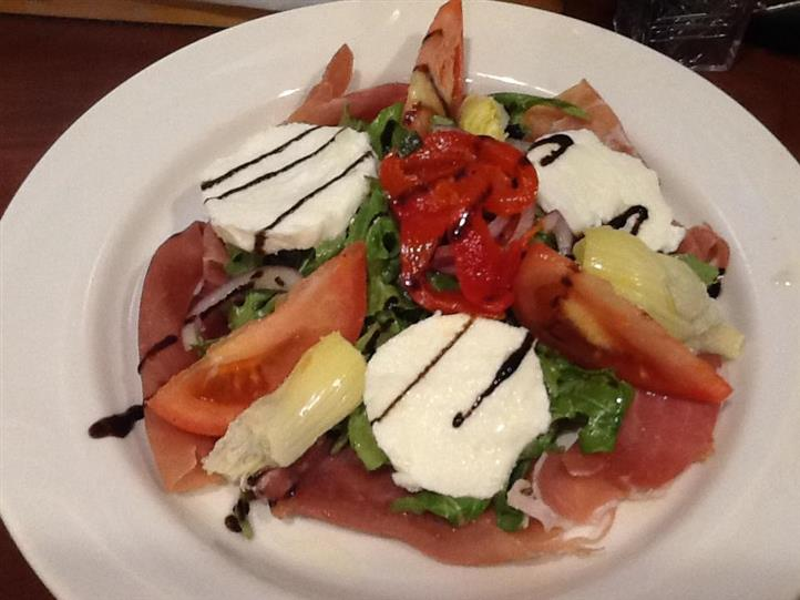 salad with several slices of tomato and mozzarella