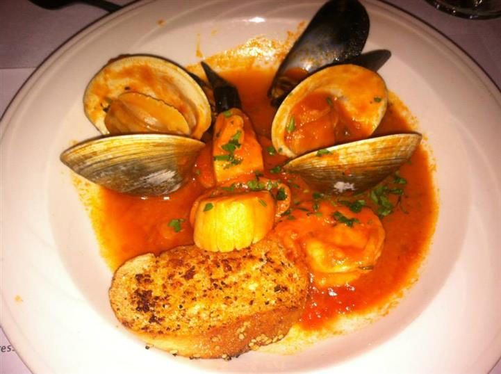 clams and mussels served in an orange sauce