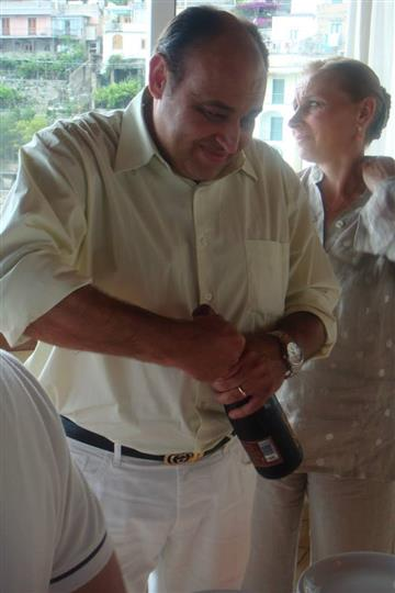 a man opening a bottle of wine