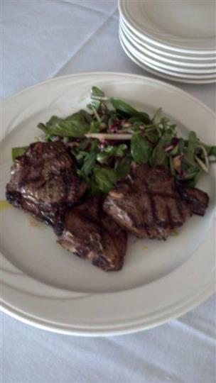 steak served with a side salad