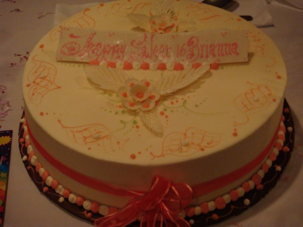 "a cake that reads, ""Happy Sweet 16 Brianna"""