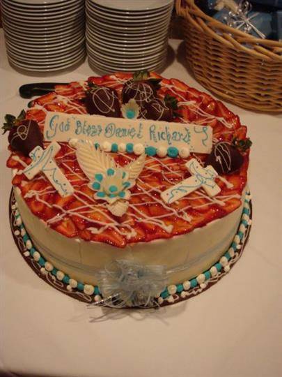 "a cake decorated with crosses that reads, ""God Bless Daniel Richard"""