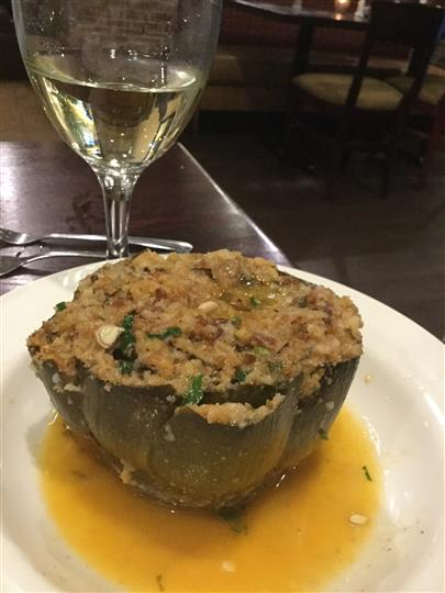 stuffed mushroom with a glass of white wine
