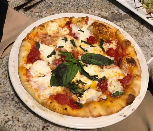 personal-size cheese pizza pie with basil