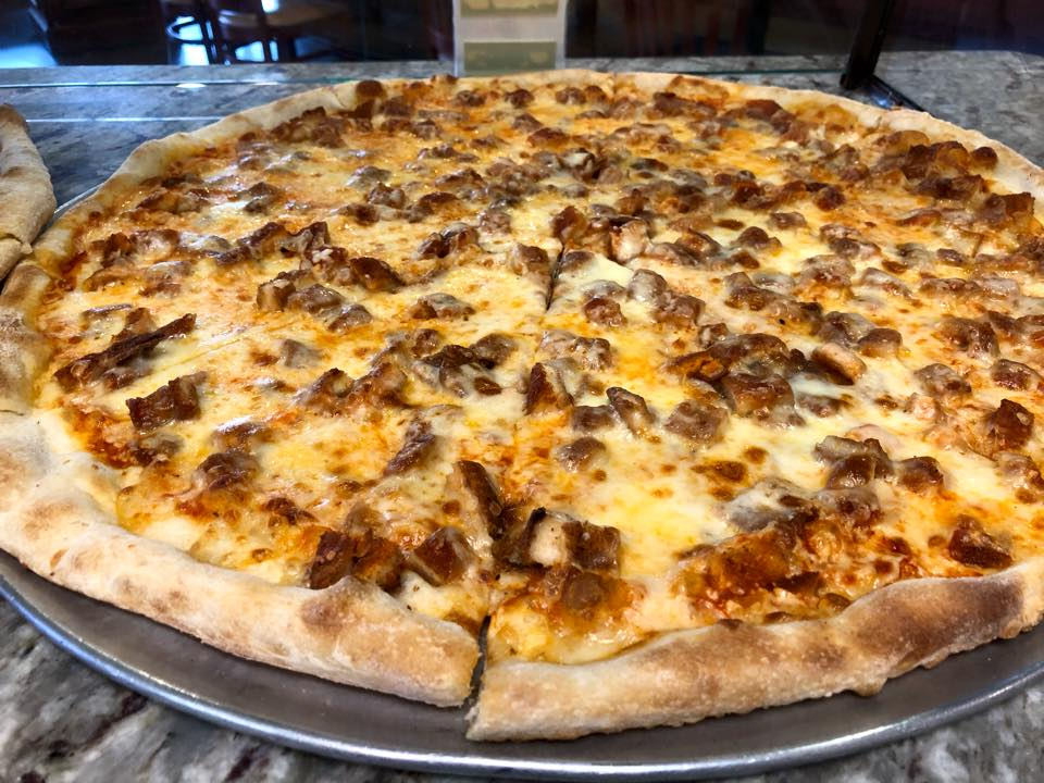 cheese pizza topped with sausage