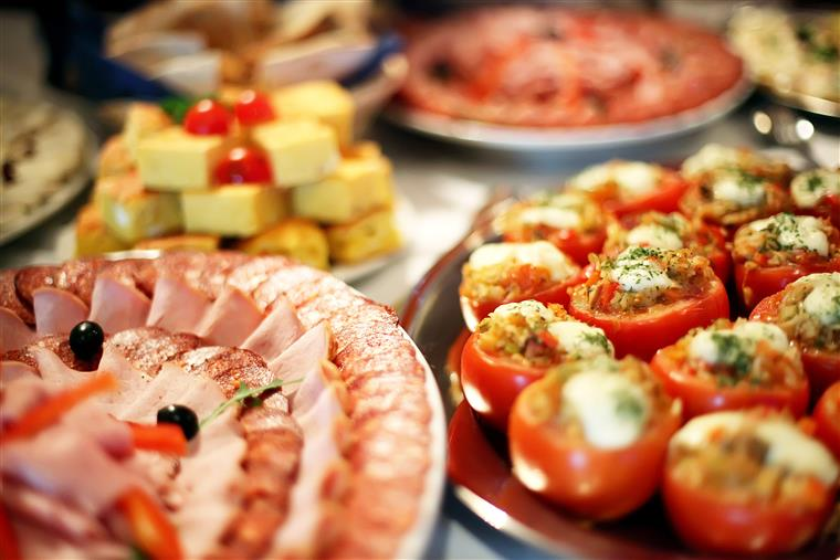 Assorted trays with appetizers on a table-top