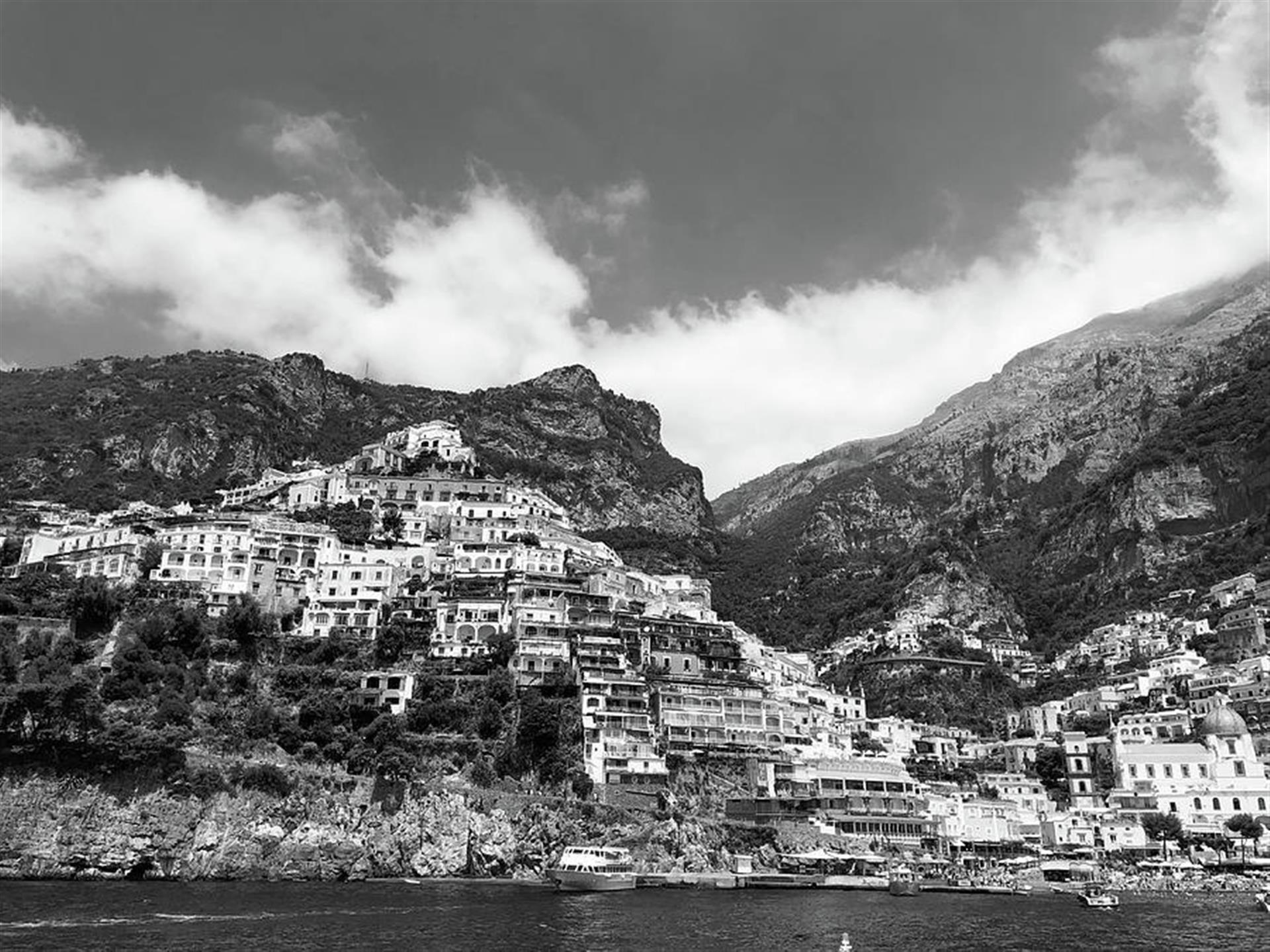 houses on a cliff in italy on the coast