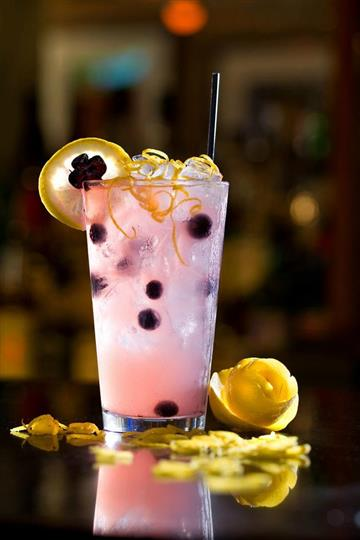 Beverage with lemon garnish and berries