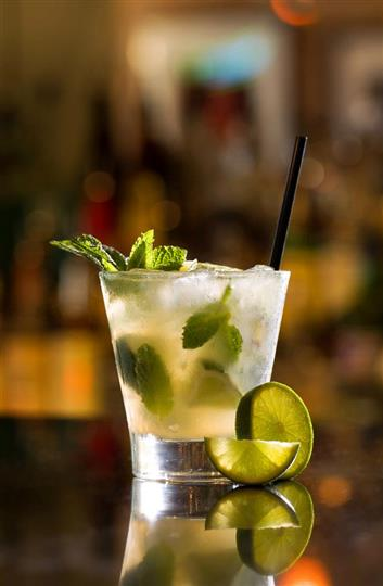 Beverage with lime garnish