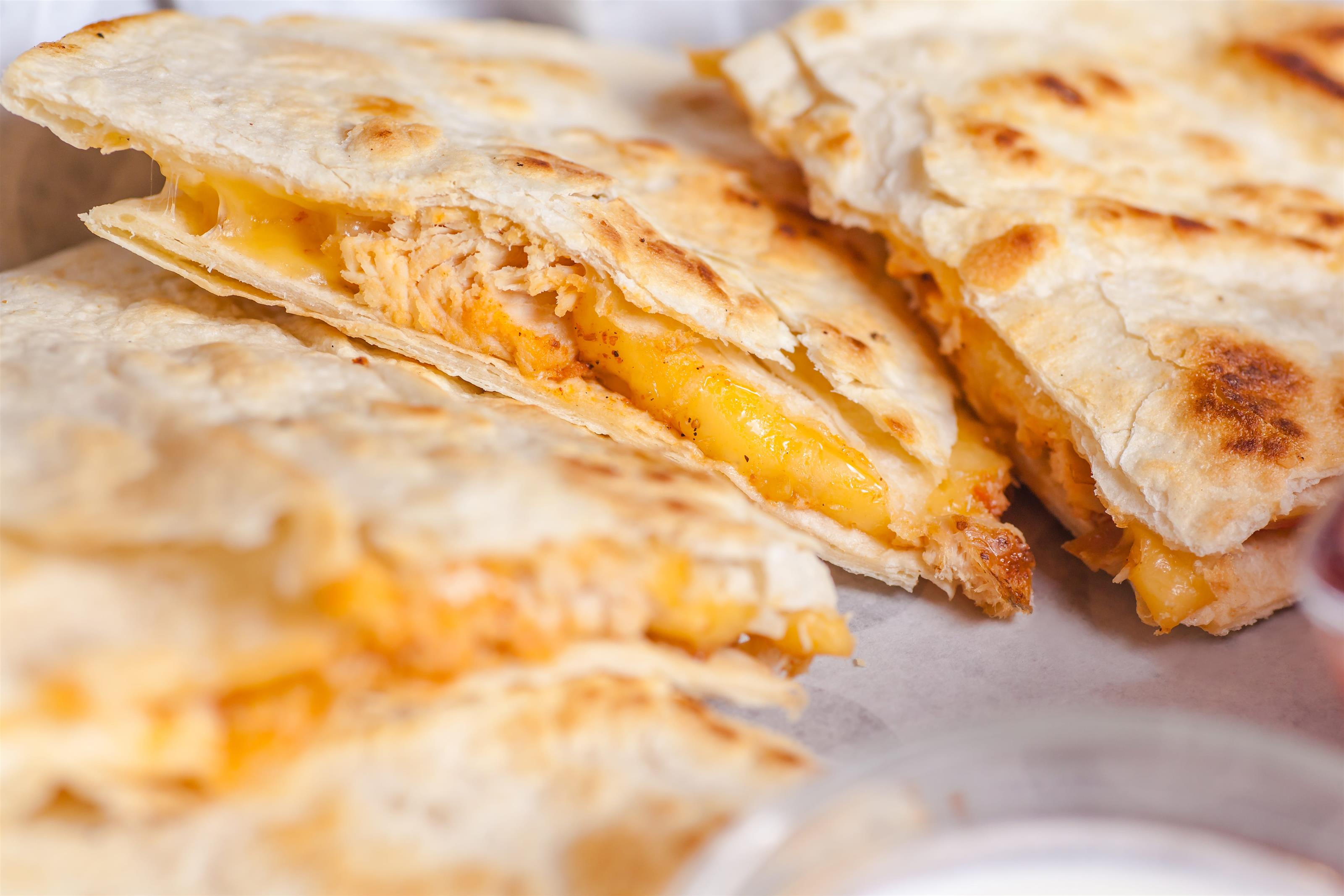 Chicken quesadillas on clear dish