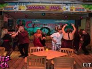People dancing in bar in front of stage