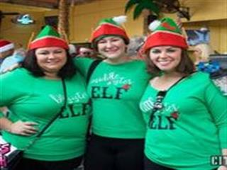 Women in elf tee shirts posing for photo