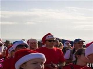Spectators at beach in christmas outfits