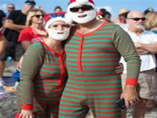 Man and woman in matching christmas pajamas