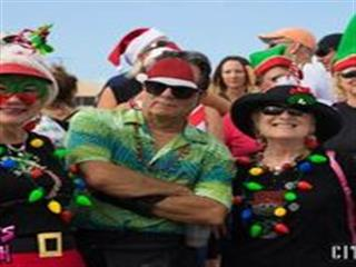 Men and women wearing holiday attire