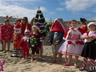 Children in holiday costumes on beach