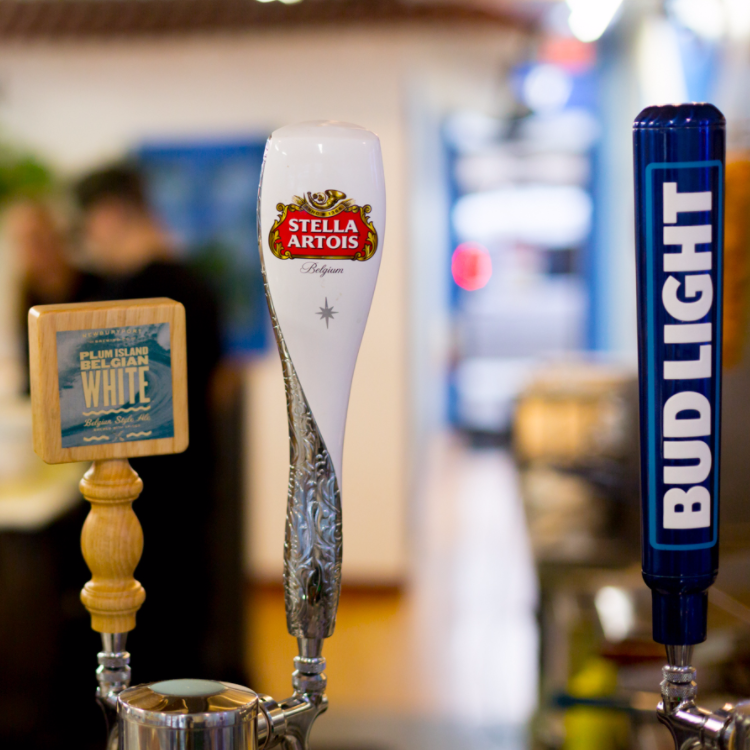 Three tap handles. Stella Artois, a Belgian White, and Bud Light.