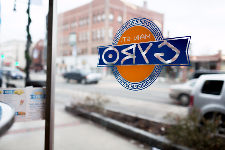 Main Street Gyro Window Decal, with cars on street in the background.