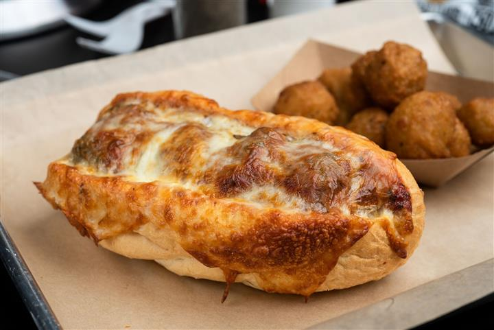 Meatball Parm sub with side of tater tots