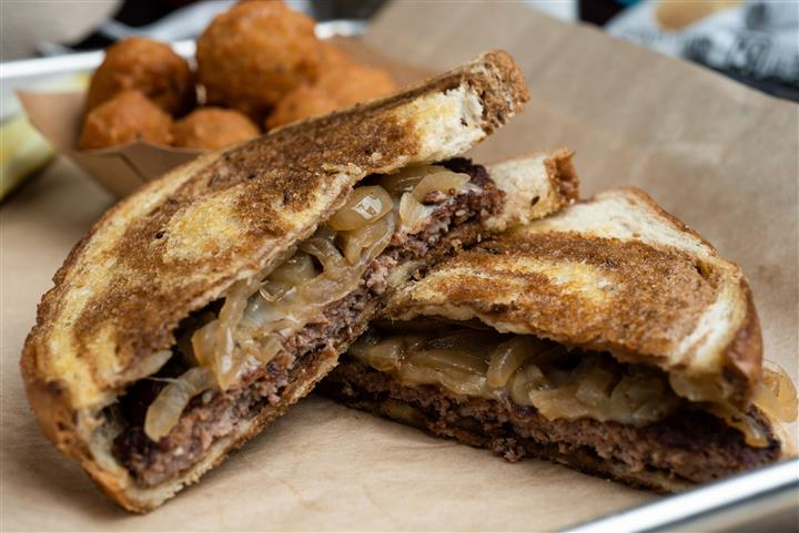 Angus beef, swiss cheese, and grilled onion on rye with side of tater tots