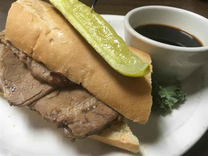french dip with a side of a pickle