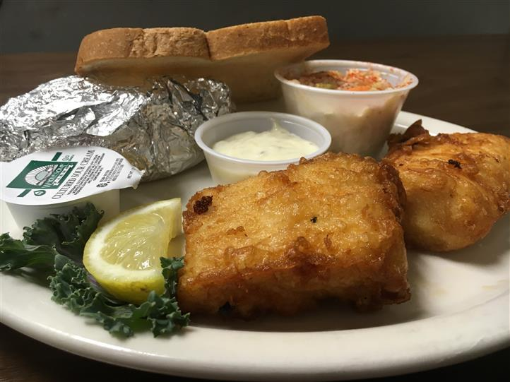 fried fish and tartar sauce with a side of cole slaw and toast