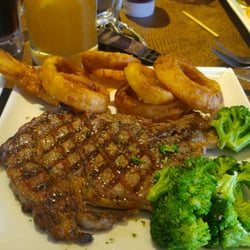 Steak, onion rings and broccoli