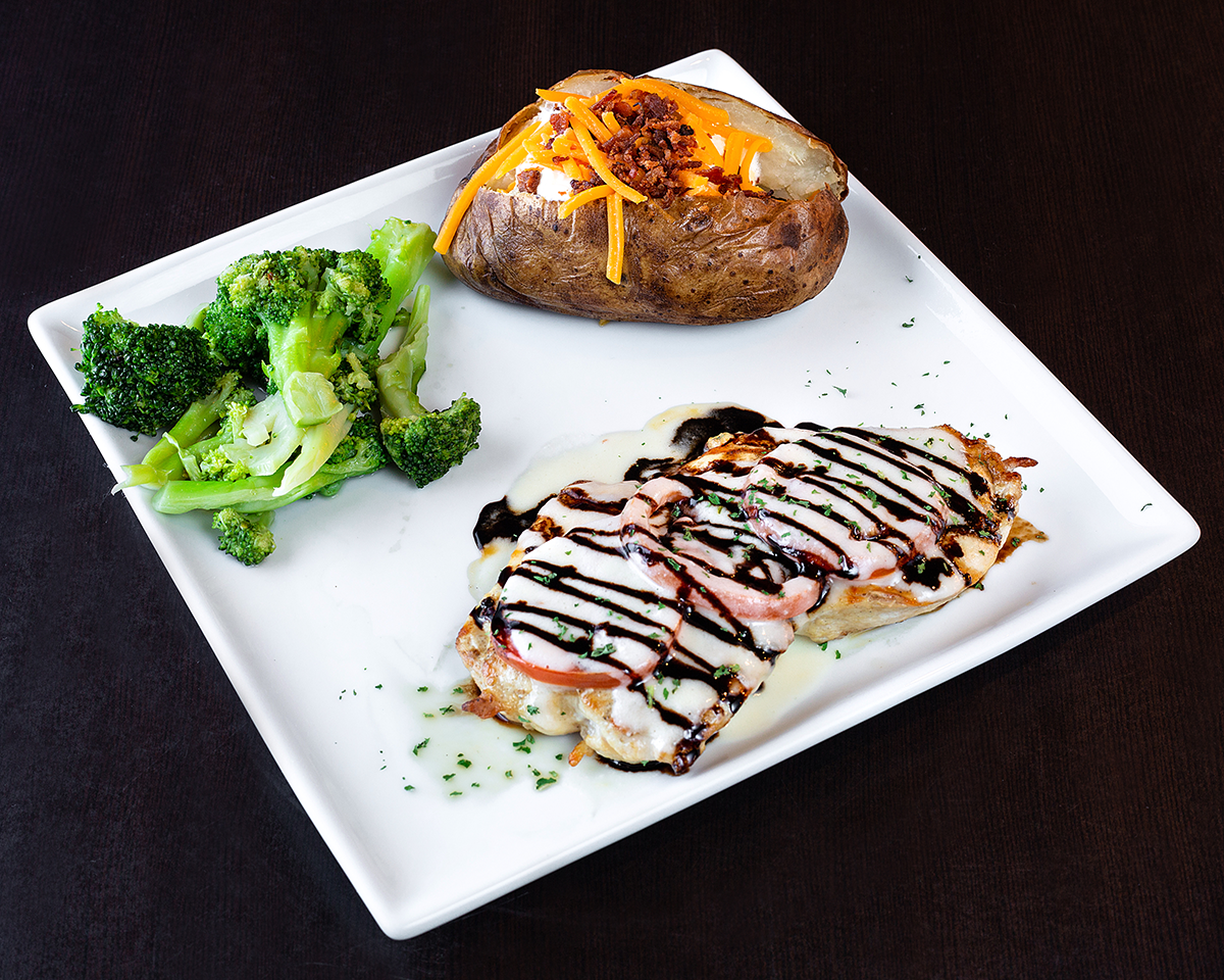 Wood-fired chicken breast topped with roma tomatoes, lemon wine sauce and a balsamic reduction.