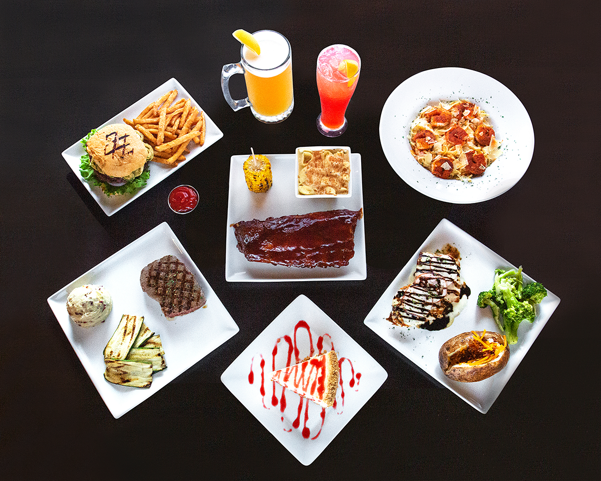 Aerial photo of 6 plates of food with 2 drinks on the side