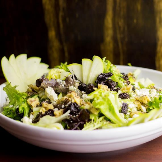 Lisa's Chopped Michigan Salad. Crisp greens, chopped walnuts, bleu cheese crumbles, diced Granny Smith apples and dried cherries. Served with your choice of fat-free raspberry vinaigrette or balsamic vinaigrette.