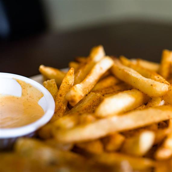 french fries with dipping sauce on the side.