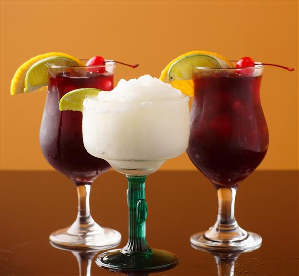 3 Beverages in a glass with lemon garnishes