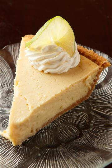 Slice of pie topped with cream and a lemon slice