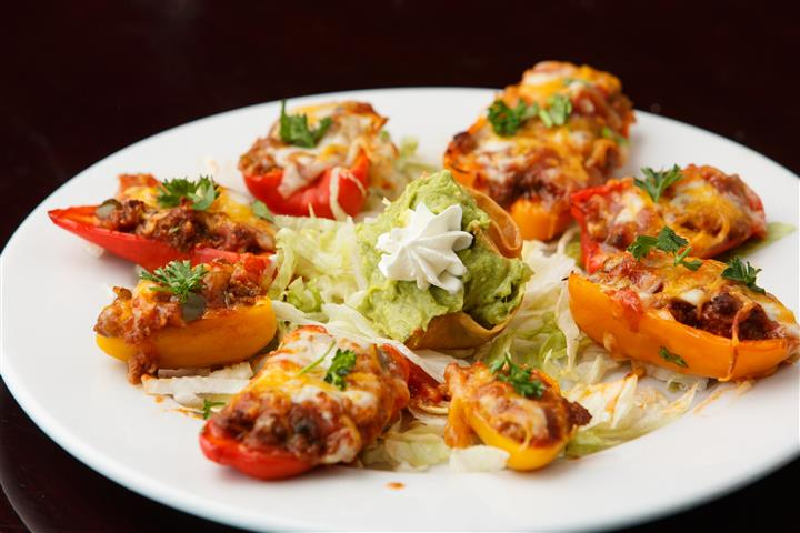 Stuffed peppers on a platter with lettuce in the center