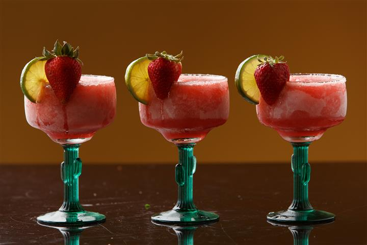3 Strawberry beverages with Strawberry and lime garnish