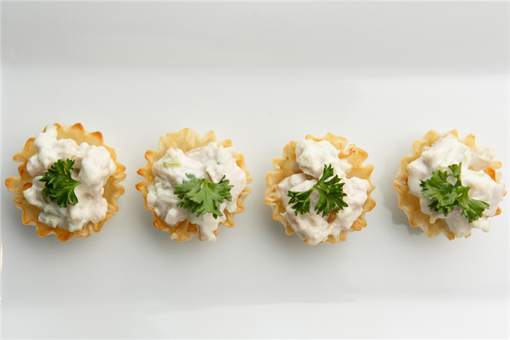 4 hors d'oeuvres on plate from an aerial angle