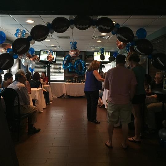 Interior shot of the restaurant decorated with blue and white baloons