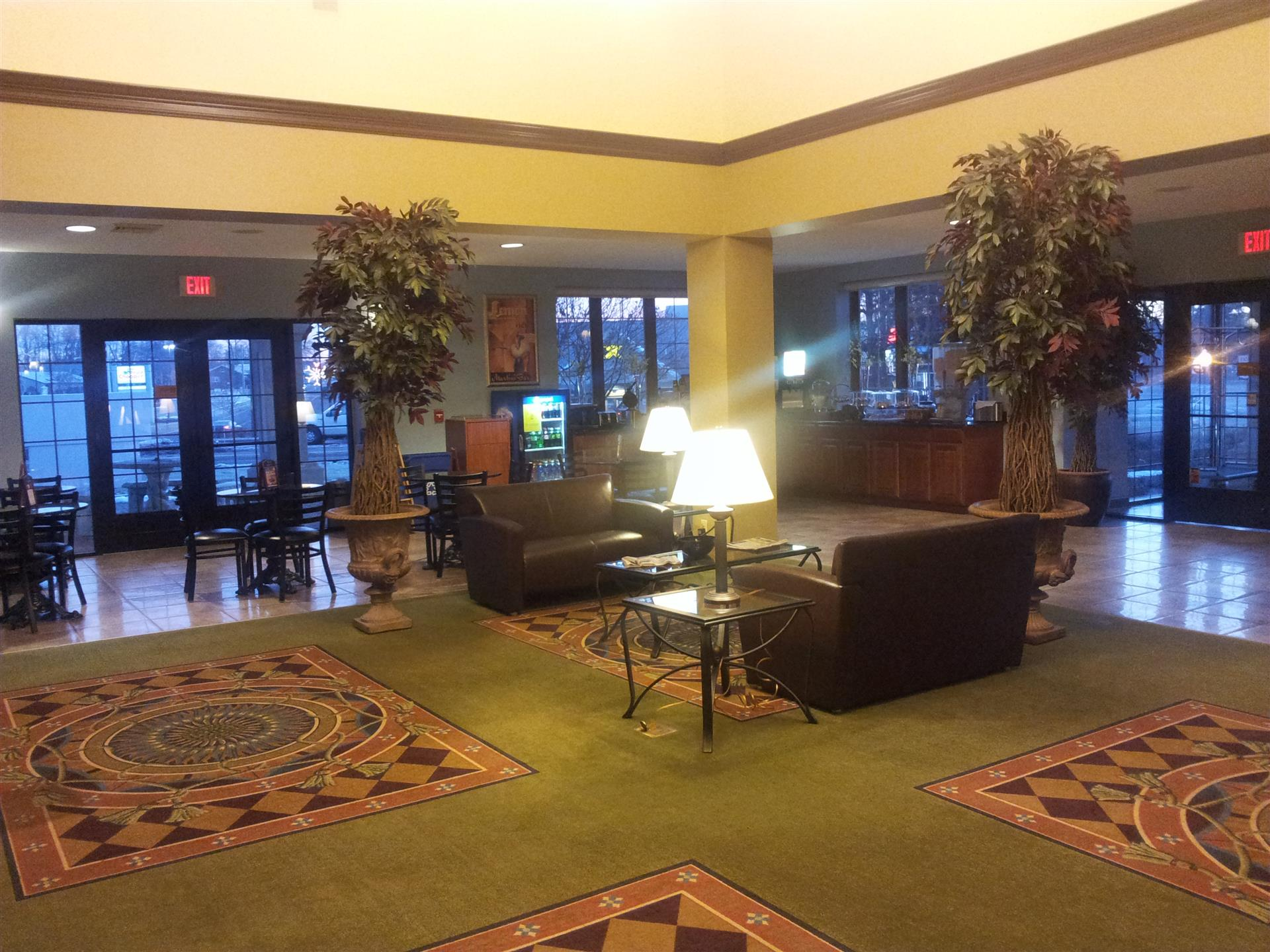 inside lobby with two padded chairs, lamps and carpet