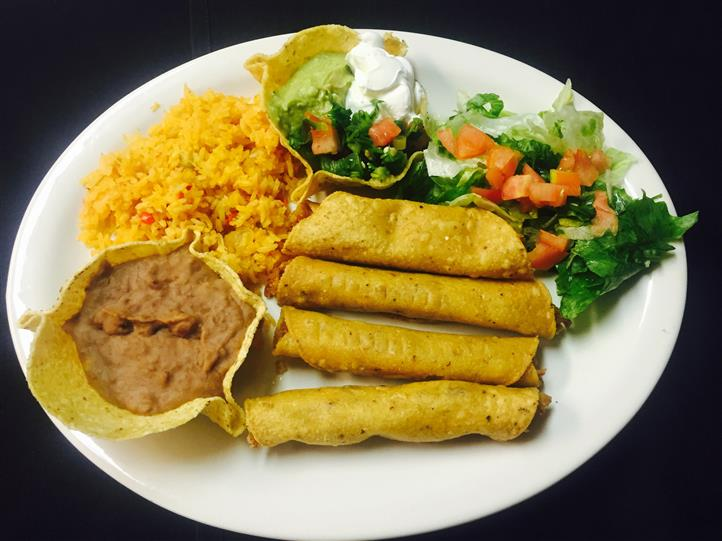 4 taquitos with a side of refried beans, rice and lettuce