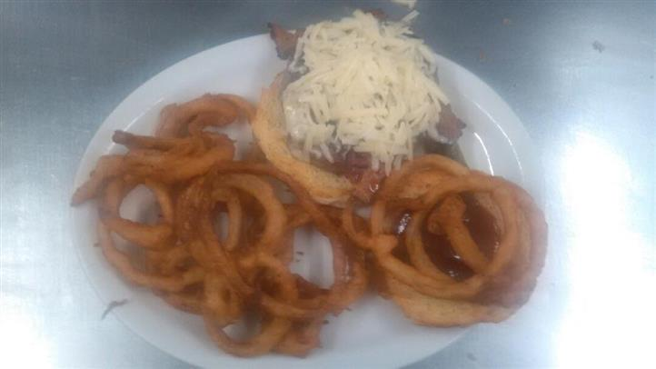 cheesebuger with extra cheese and a side of onion rings