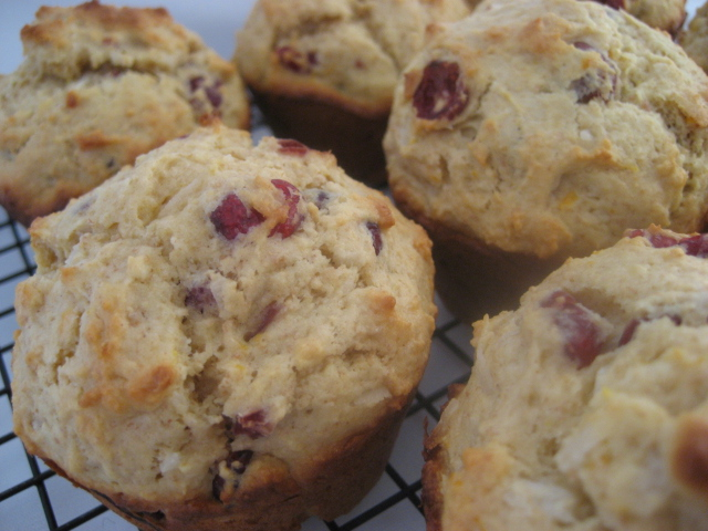 cranberry muffins on a cooling rack