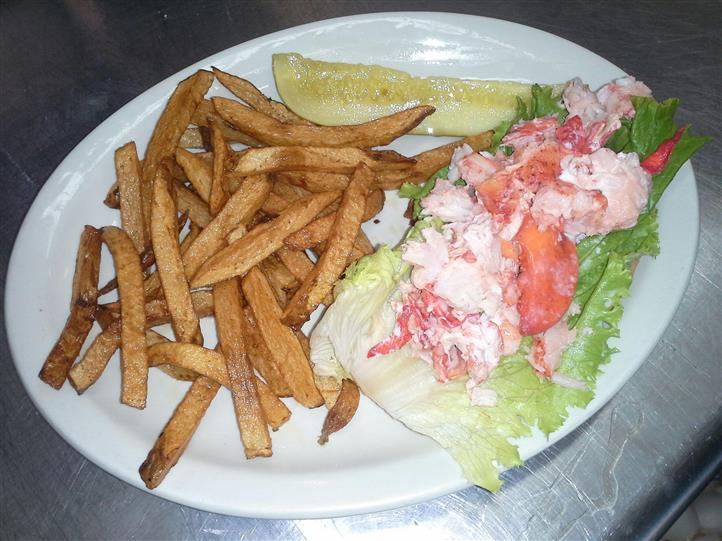 lobster lettuce wrap with fries and pickle