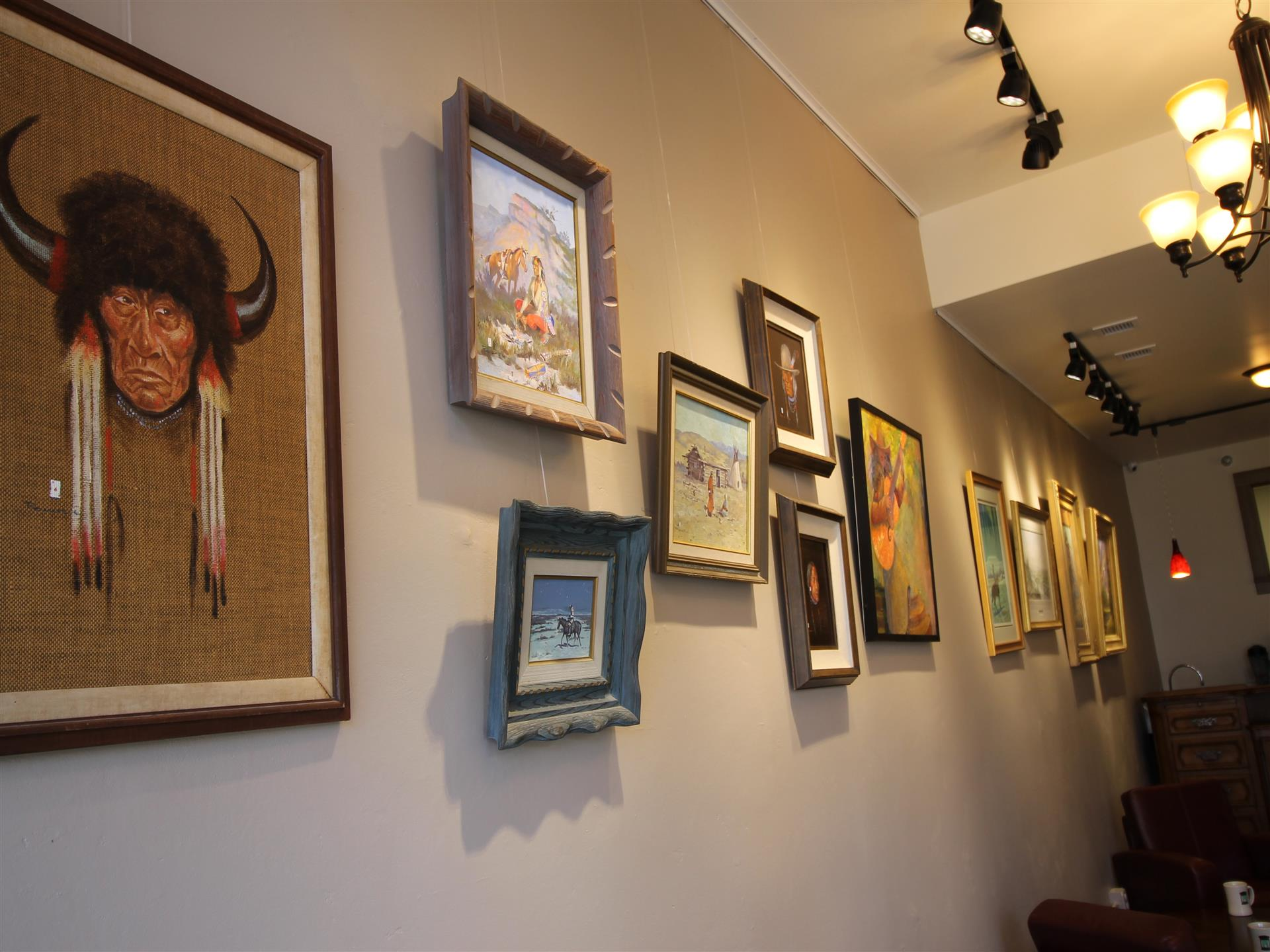 various paintings being displayed on the wall for decorations