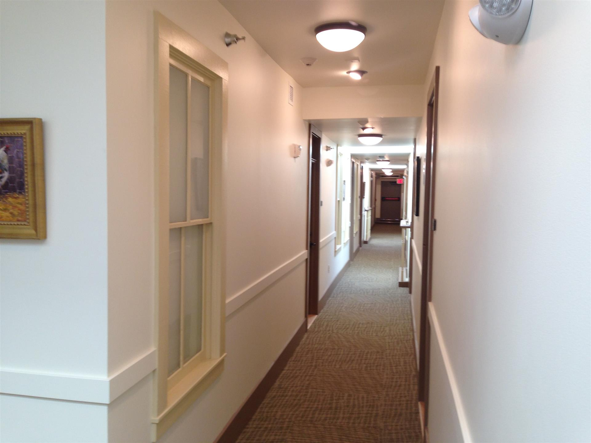 long hallway showcasing the room doors
