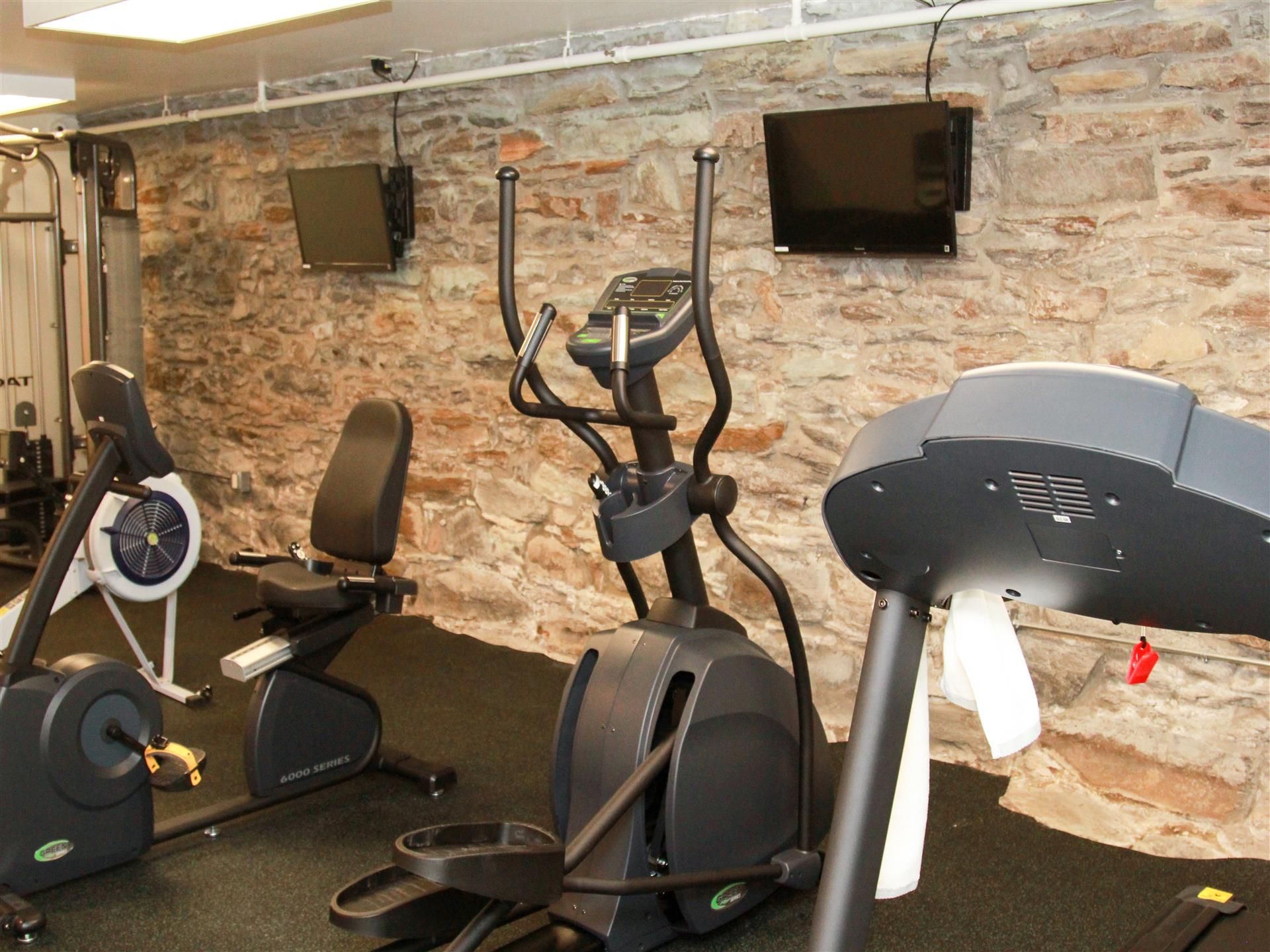 workout area with tvs and machines