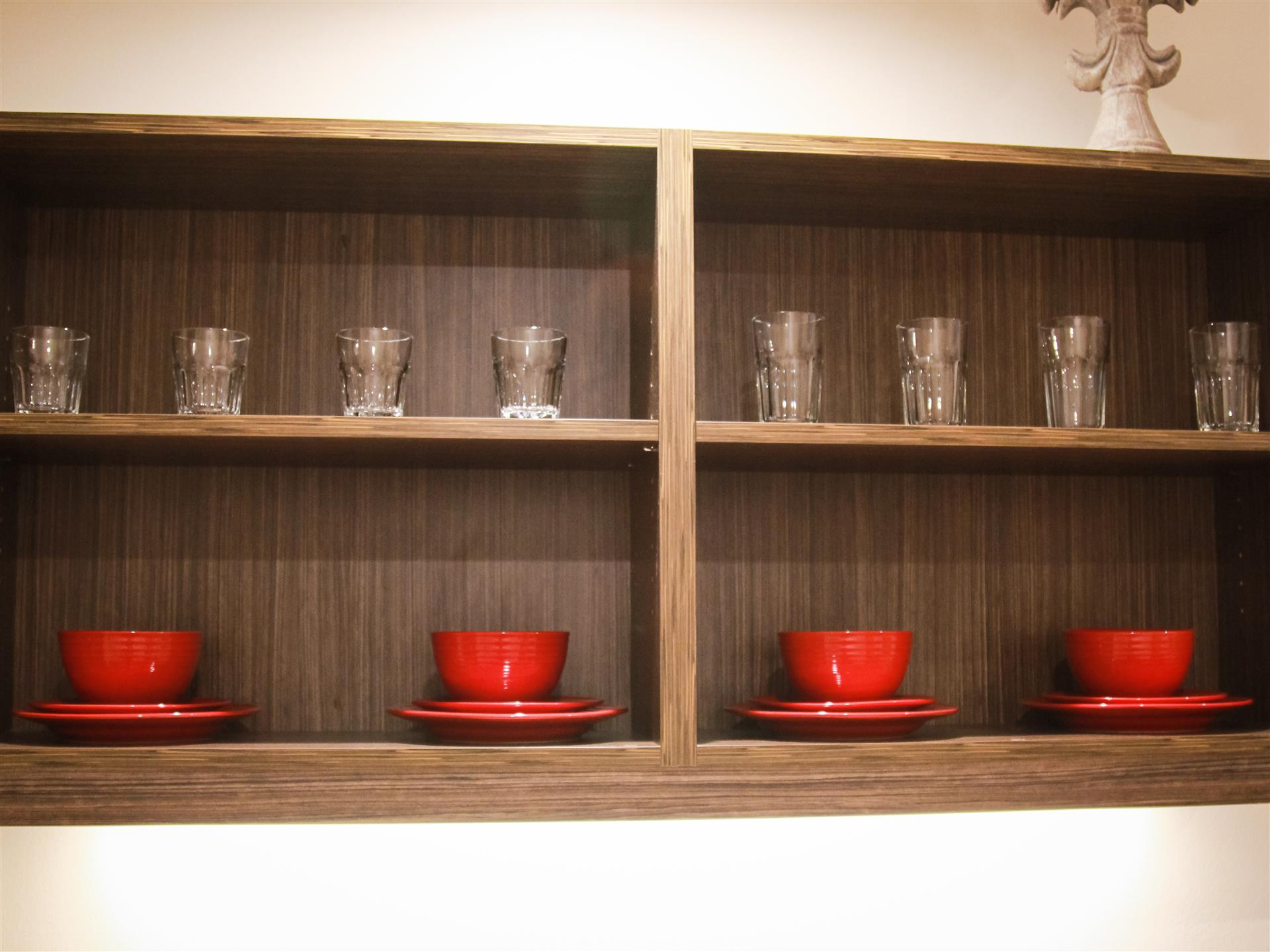 decorative cabinet with mugs and glasses