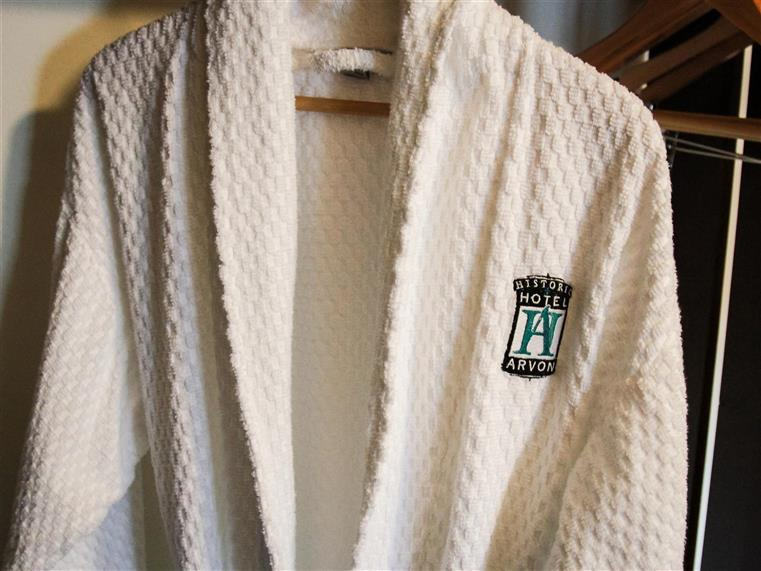 hotel arvon bathrobe on a hanger